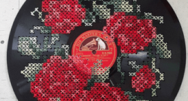cross stitched disc